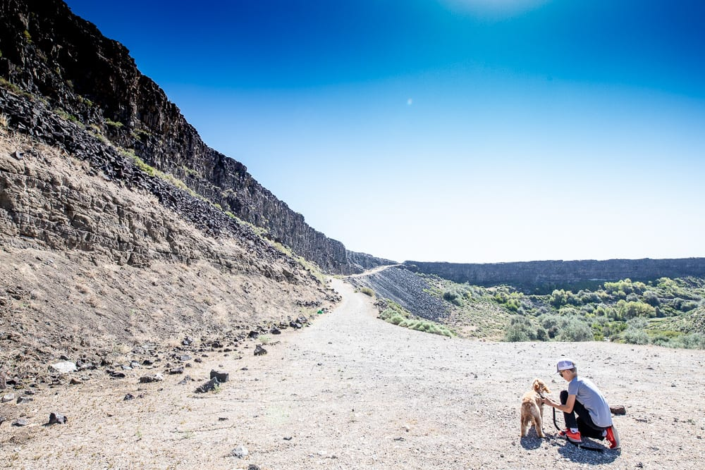 Boy hiking with cavapoo near Boise idaho