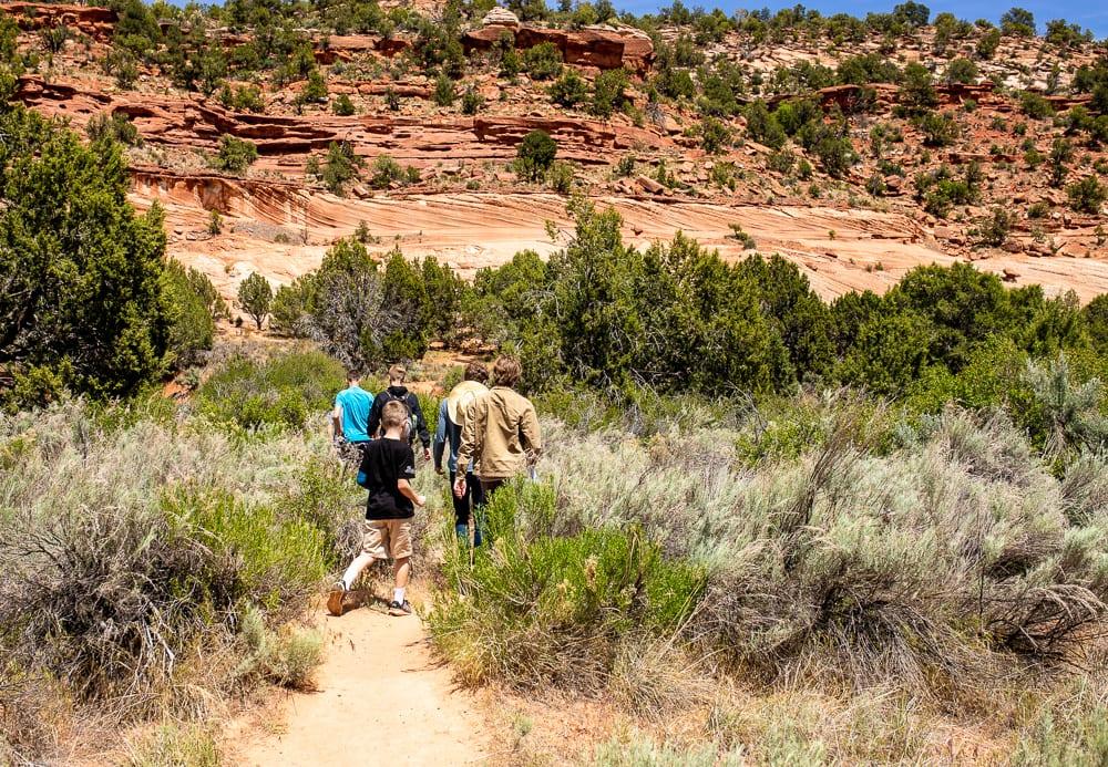 teenagers hiking in southern utah