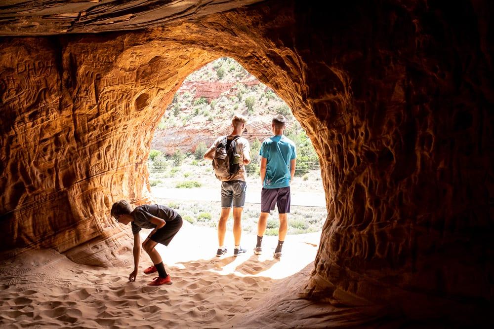 teenage boys standing in  moqui caverns