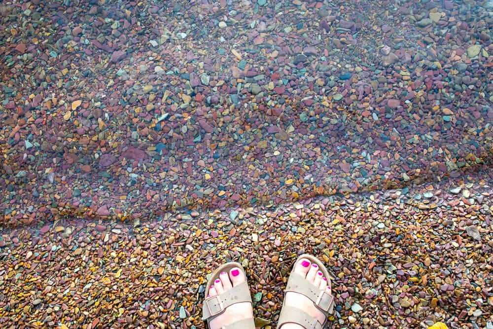 colored rocks on the shores of lake McDonald