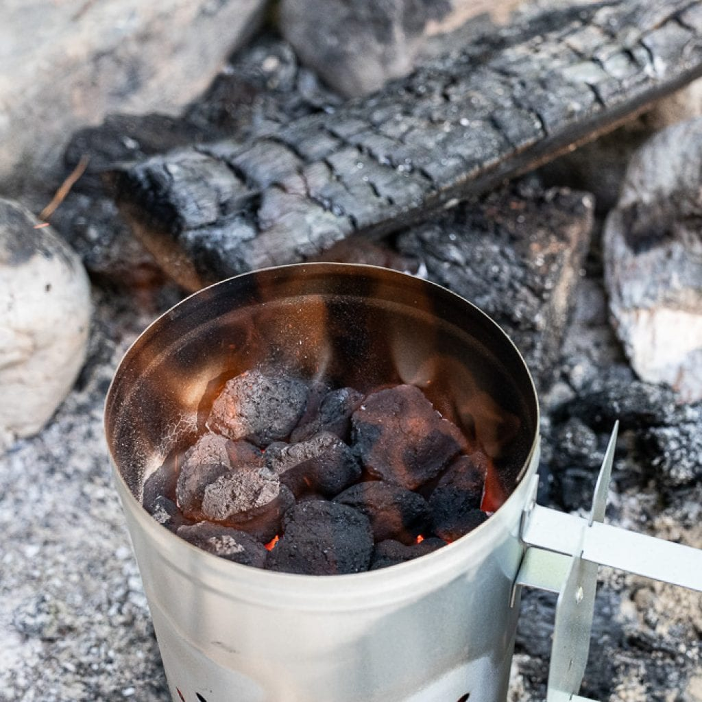 charcoal heating in chimney for dutch oven cooking