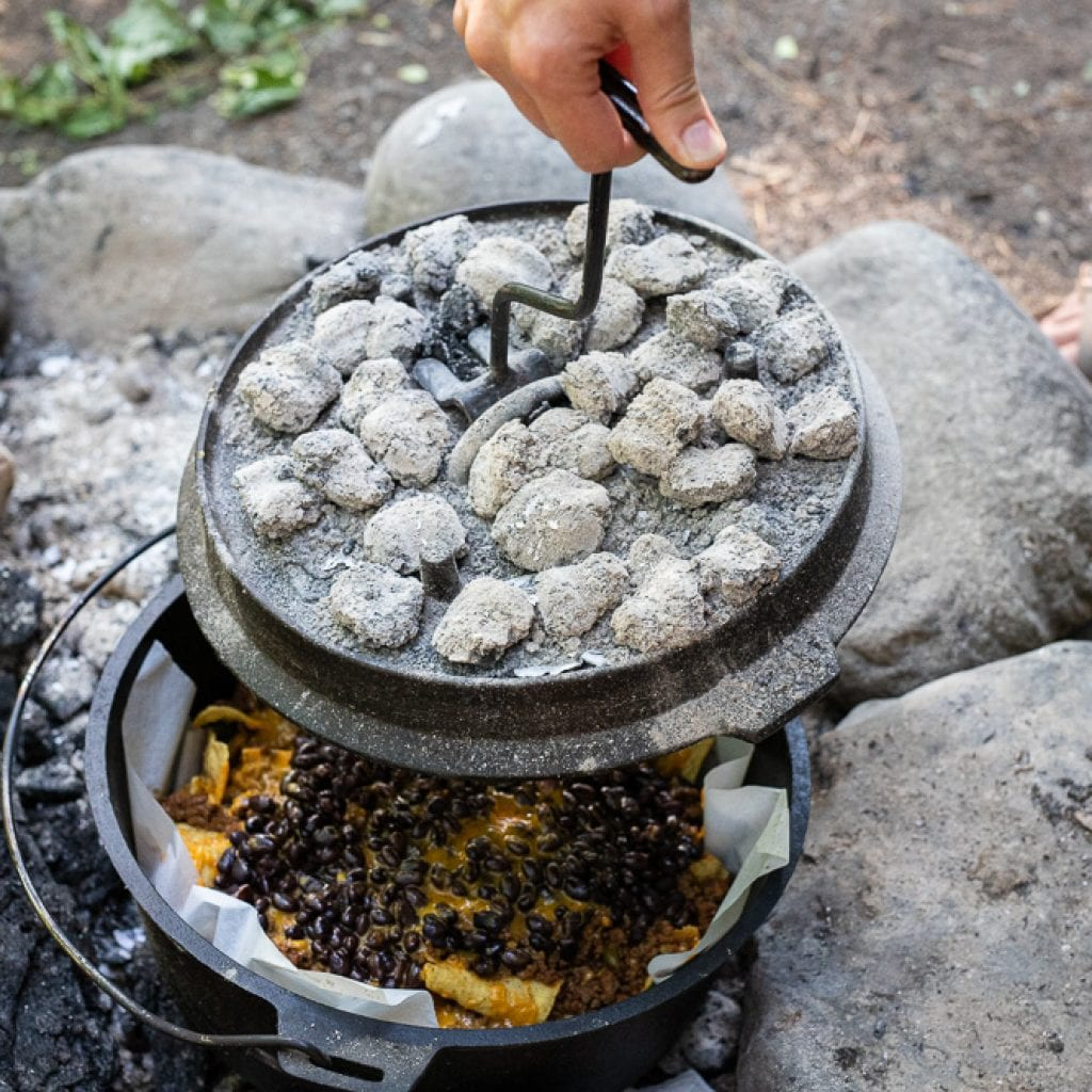 woman cooking dinner in dutch oven