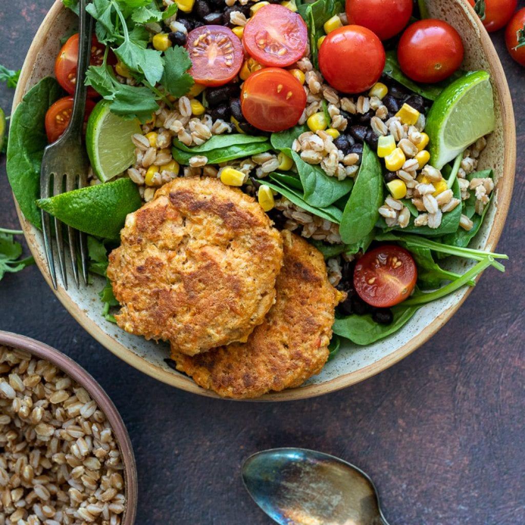 healthy salmon and grain bowl in ceramic pasta bowl