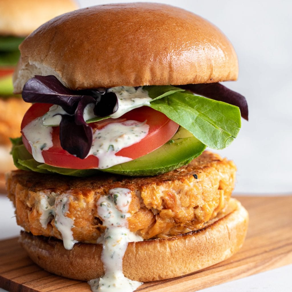 epic salmon burger on individual serving board