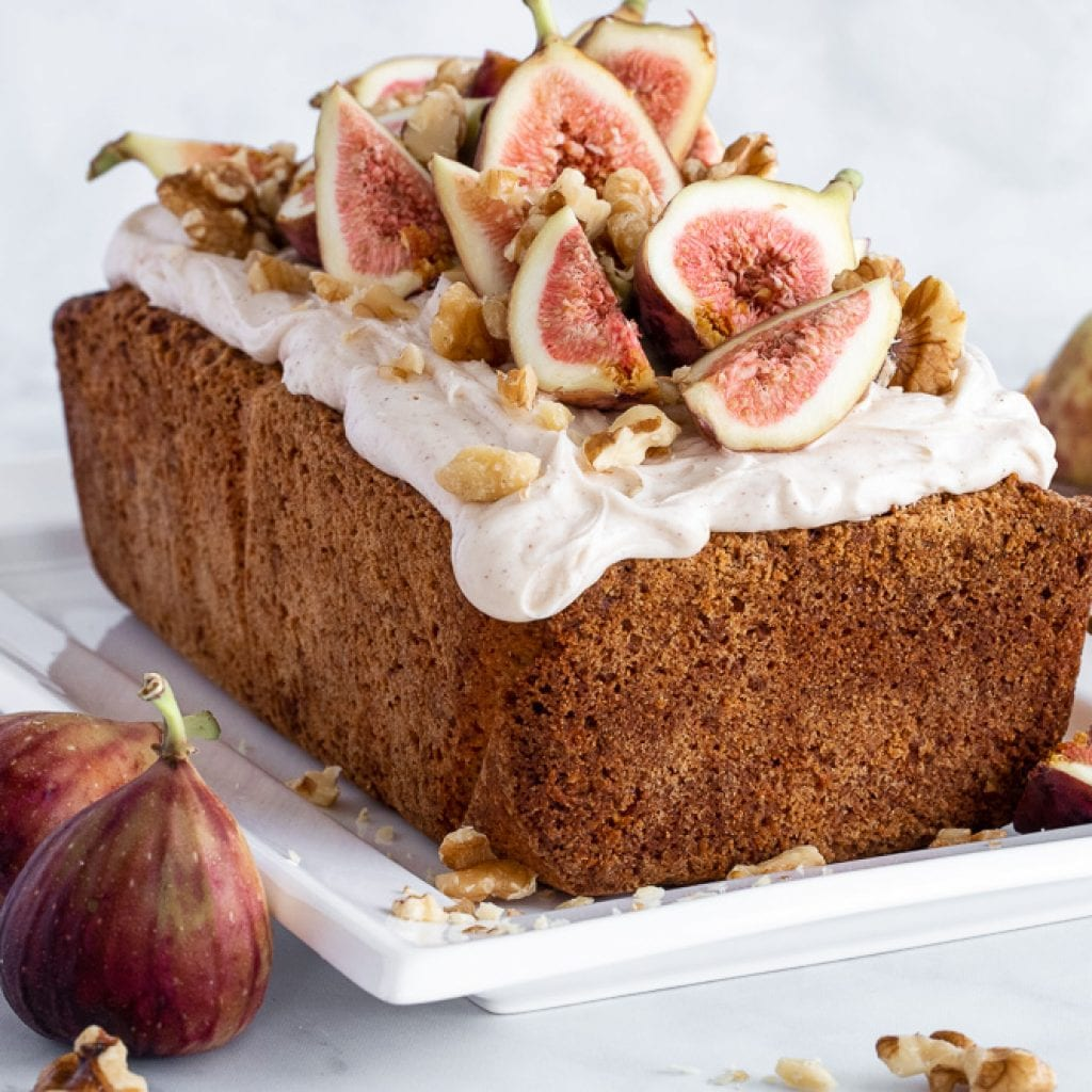 walnut pound cake with cinnamon cream cheese icing topped with fresh figs and walnuts