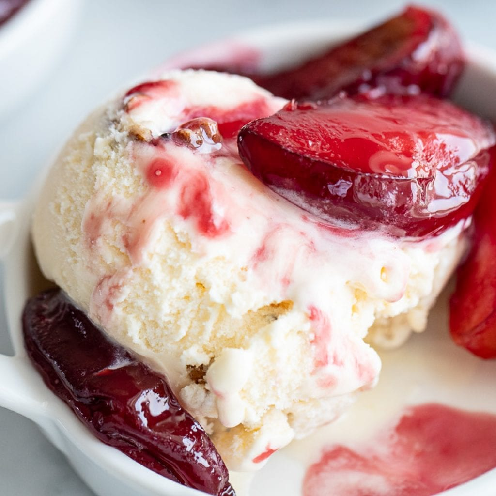 roasted plums over butter pecan ice cream
