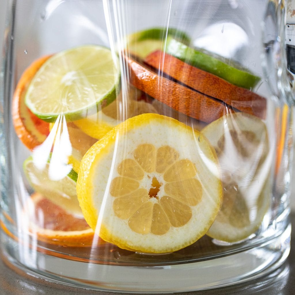 sliced citrus in pitcher for summertime sangria.