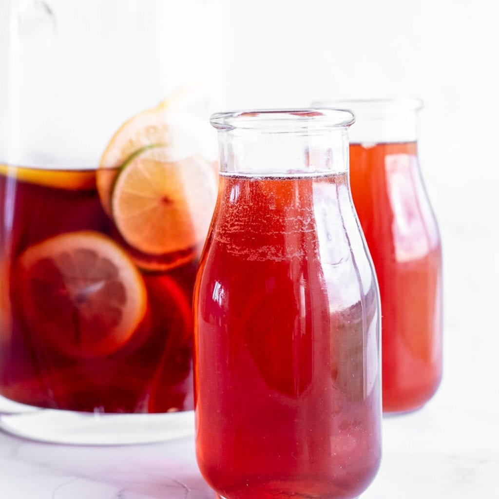 the best summertime sangria no alcohol in glass pitcher
