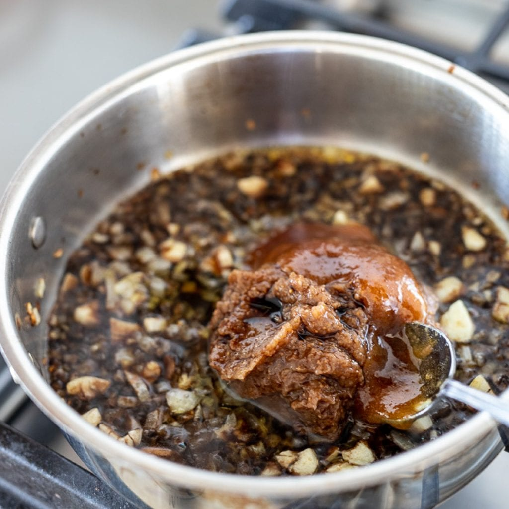 woman cooking fig balsamic sauce