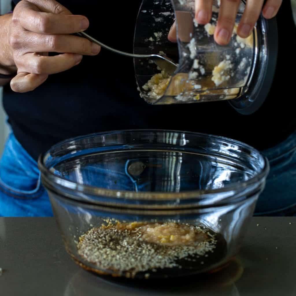 woman adding pureed pear to marinating mix for beef bulgogi