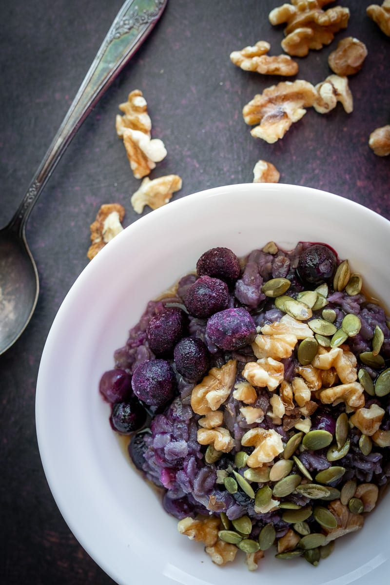 the best blueberry oatmeal in a small white bowl