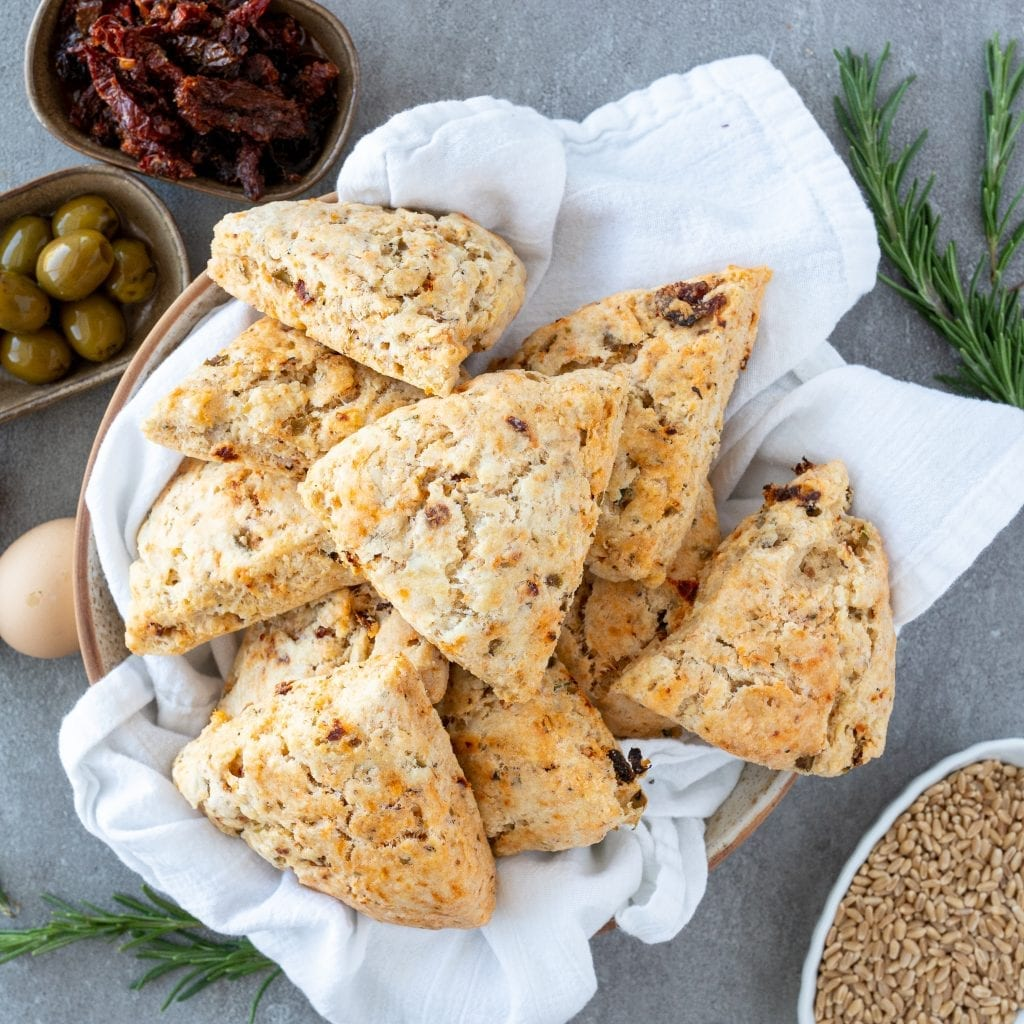 Savory Sundried Tomato and Olive Scones in ceramic bowl