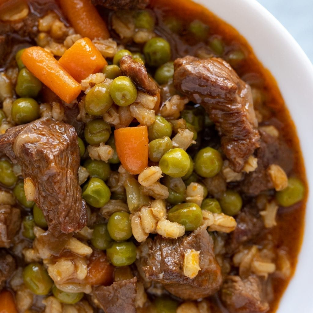 Hearty Beef Barley Soup in small white bowl