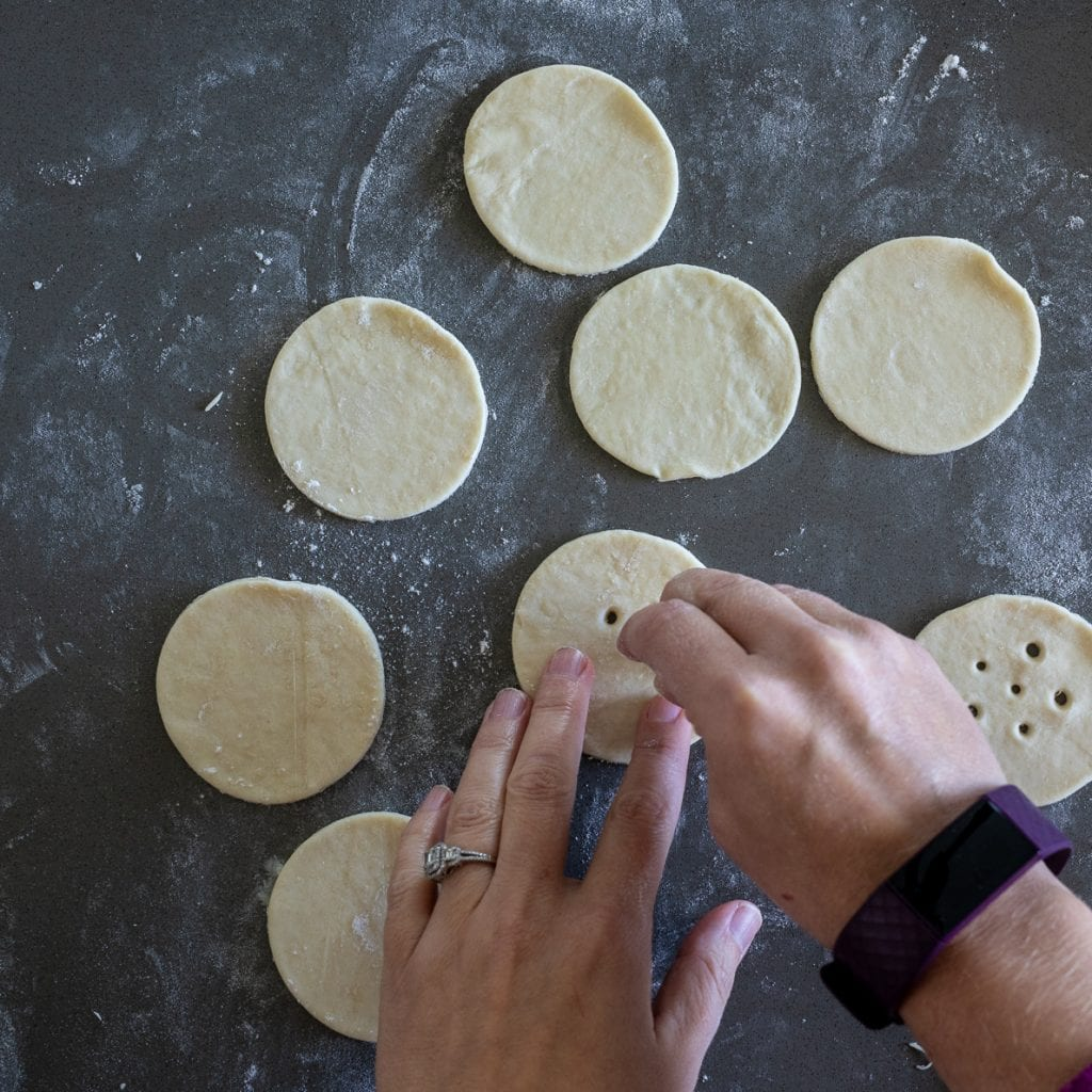 woman poking holes for ventilations on simple pie pops
