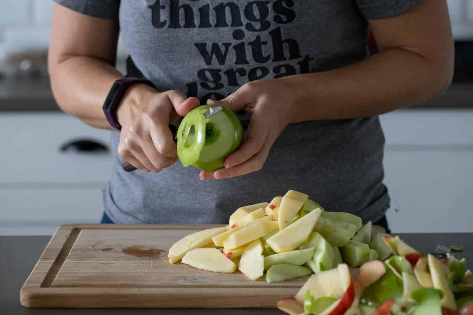 woman peeling apples for apple pie