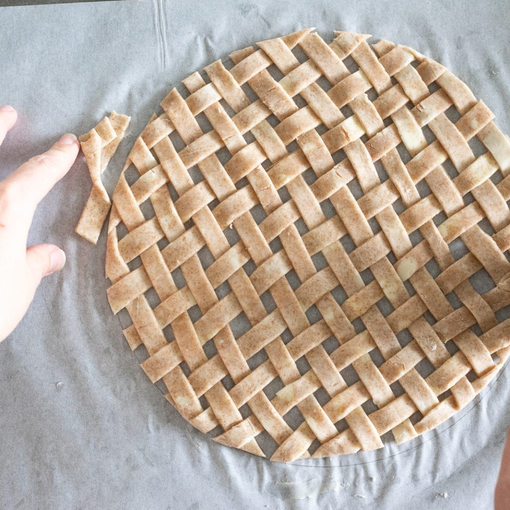 latticework cut into a circle for pie topping with whole wheat pie dough