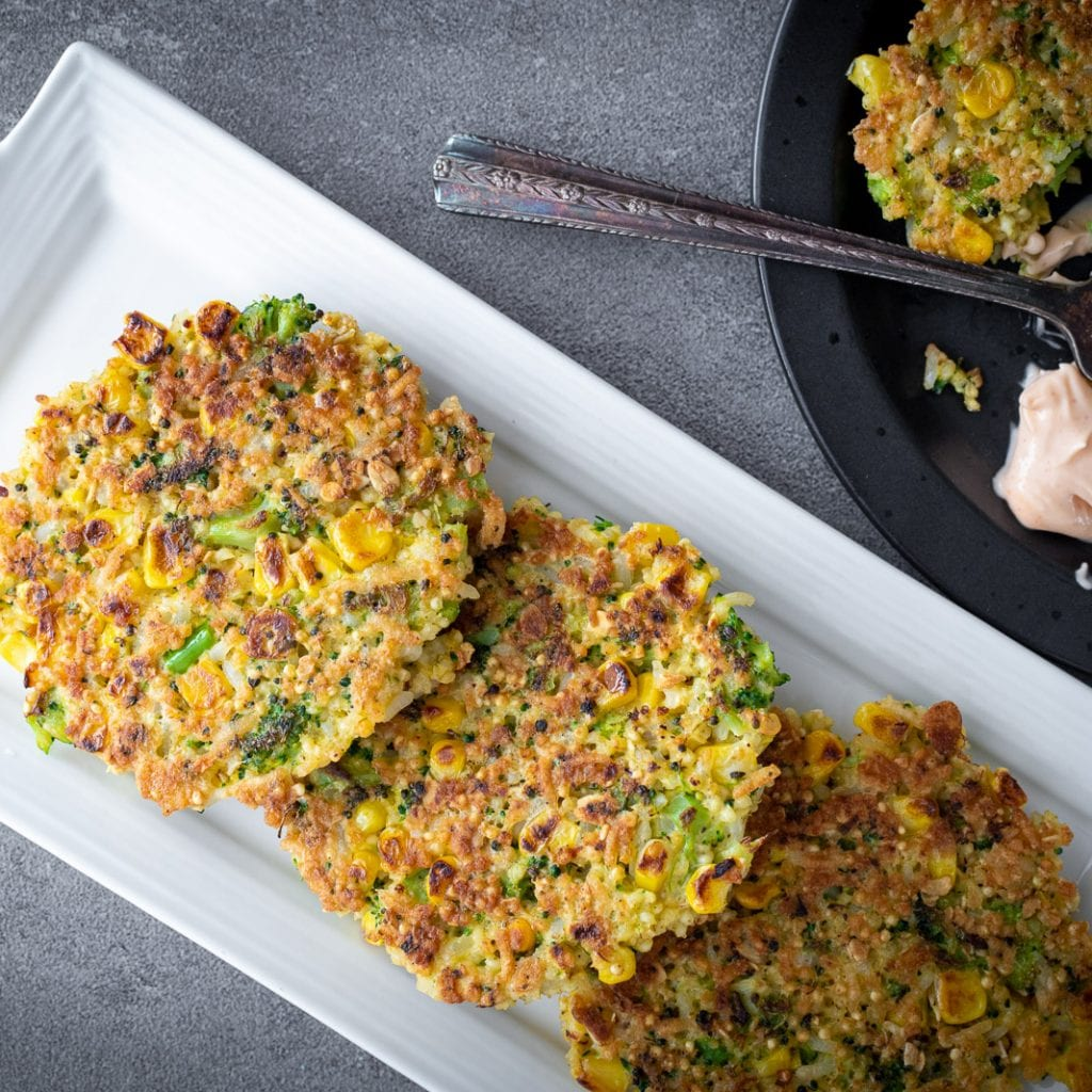 broccoli and corn millet fritters on a white serving tray