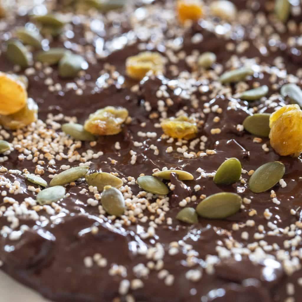 popped amaranth and golden raising on a dark chocolate bark
