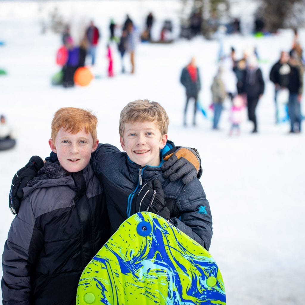 2 teenage boys with their sled at Steamboat Gulch Idaho