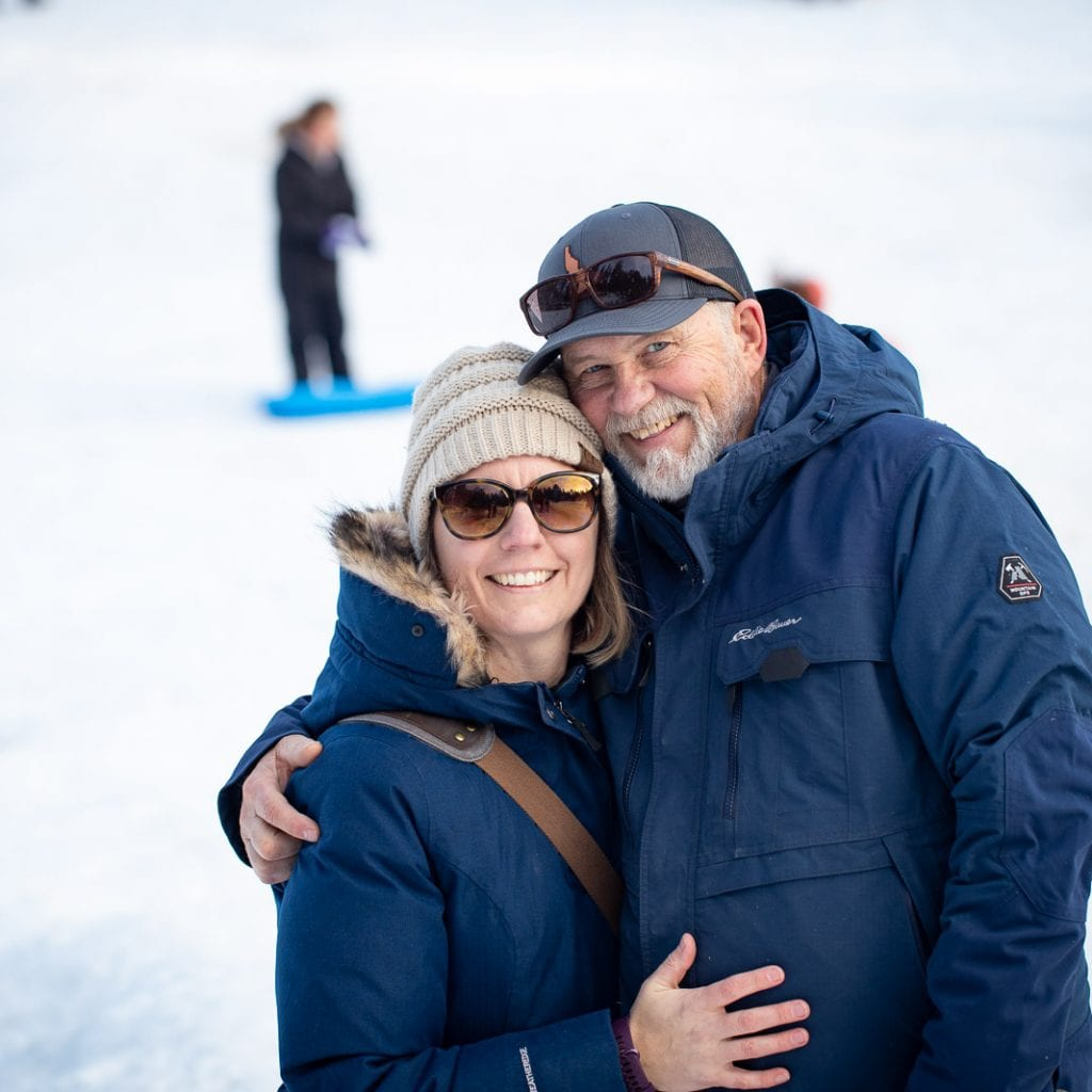 husband and wife at steamboat gulch idaho with eddie bauer winter coats on