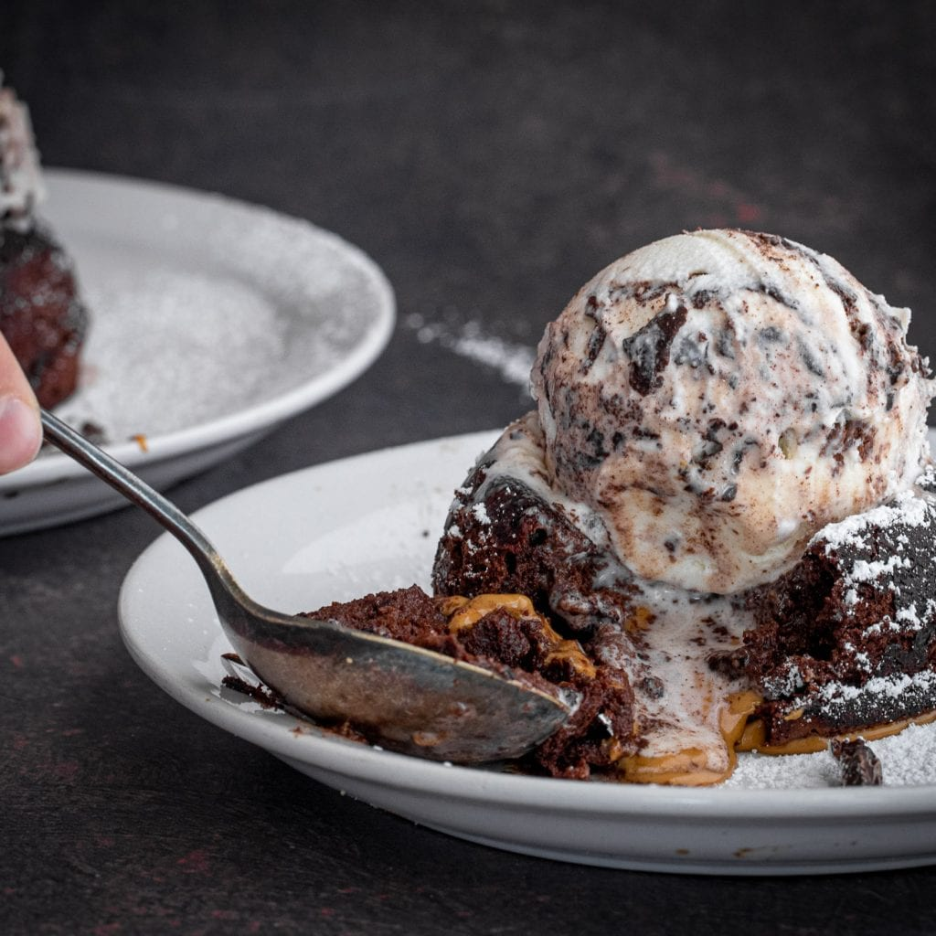 molten chocolate peanut butter cake topped with ice cream