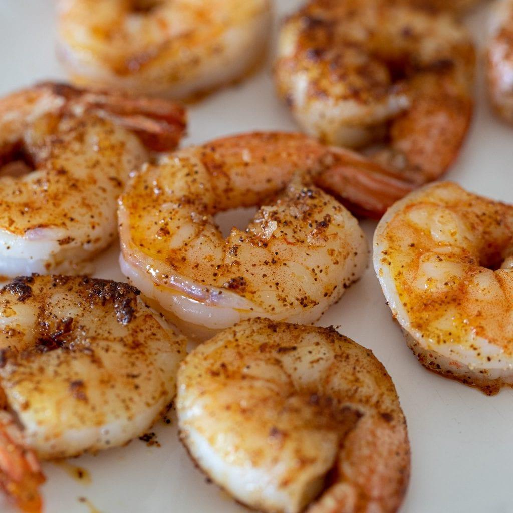 sautéed shrimp on a white plate