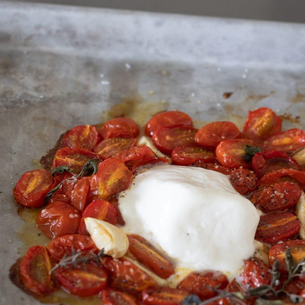 Simple Roasted Tomato Caprese on a baking sheet