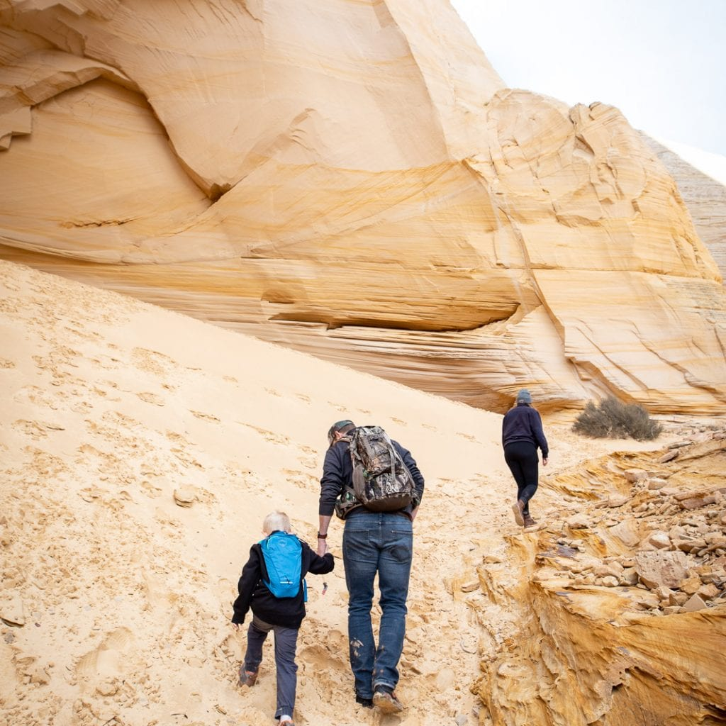 family hiking through the sand to Grand Chmaber