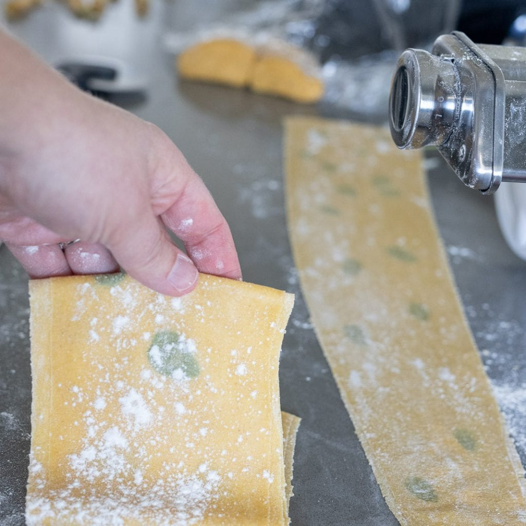 woman folding laminated pasta for hand cutting