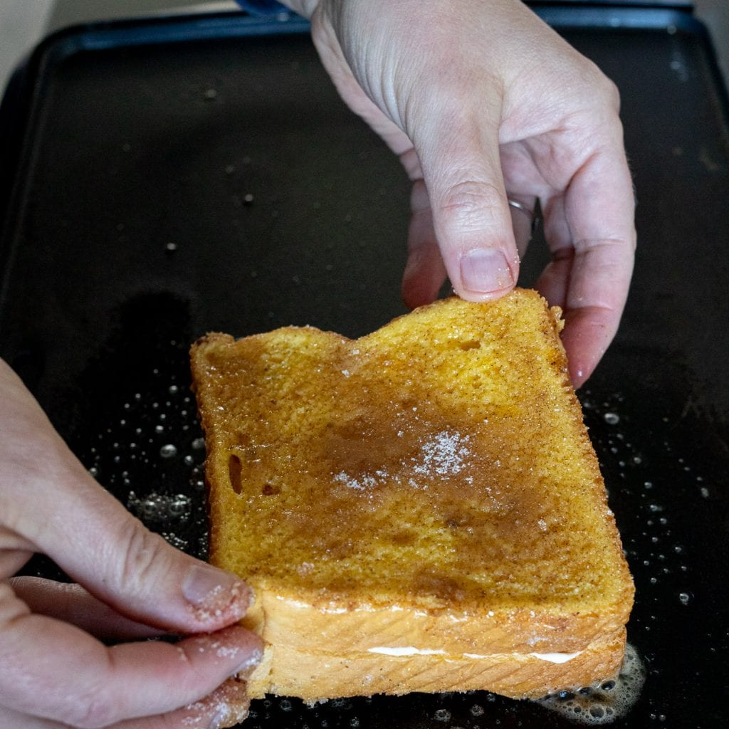 cream cheese french toast on a griddle