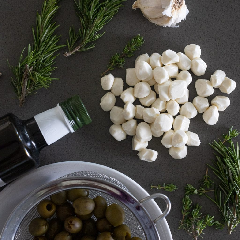 ingredients laid out on quart countertop for marinating mozzarella