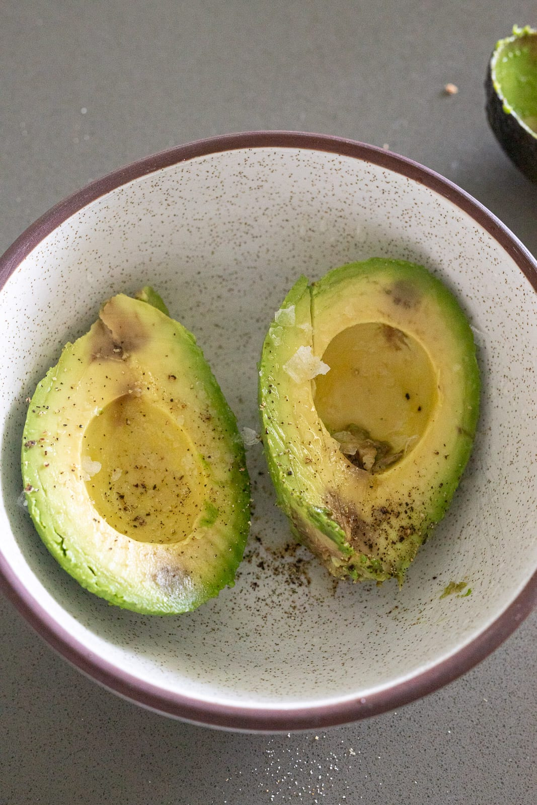 avocados in a ceramic bowl for topping appetizer.