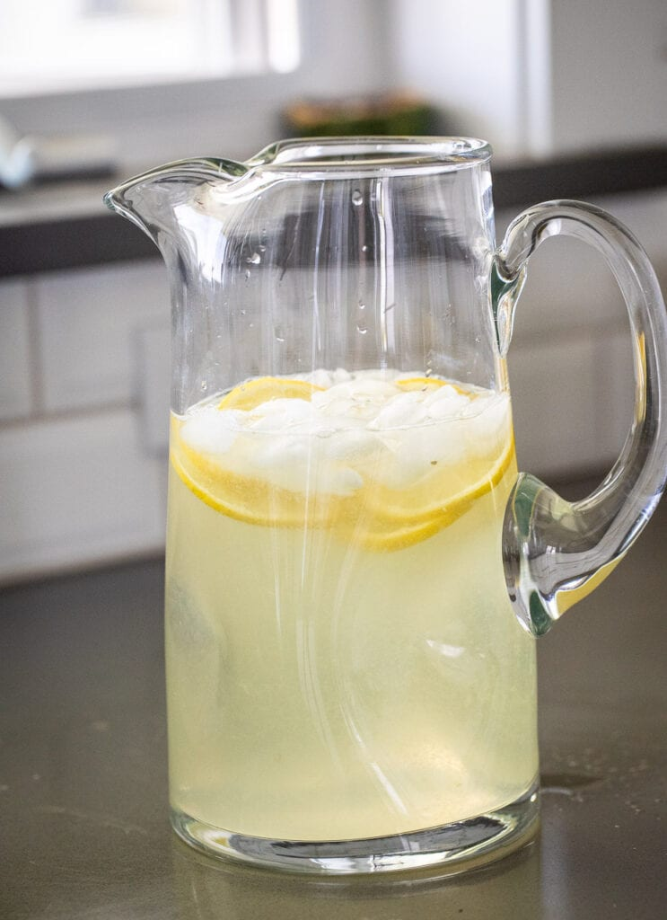 lemonade in a clear glass pitcher on the countertop