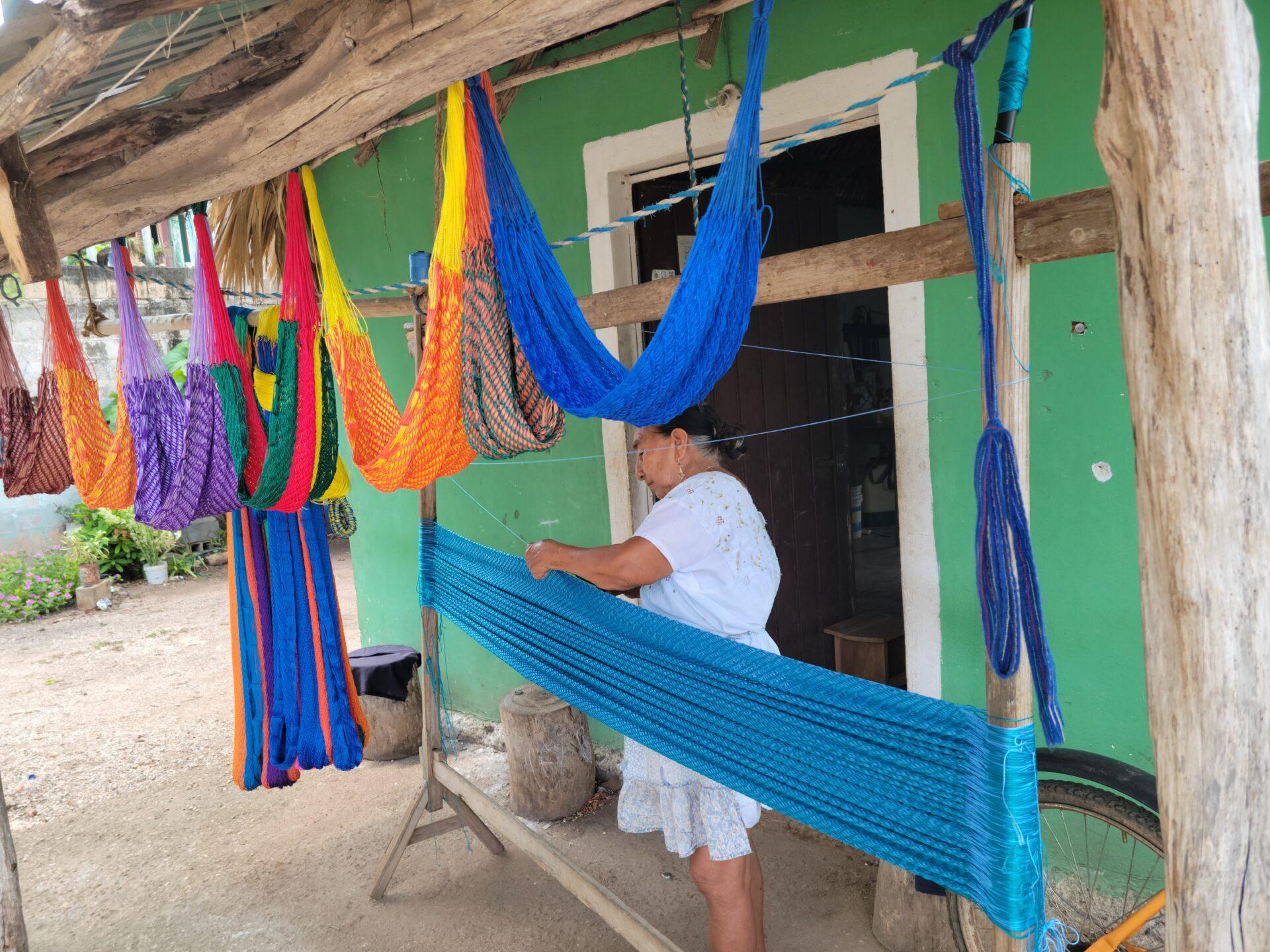 woman making hammocks in Ek Balam