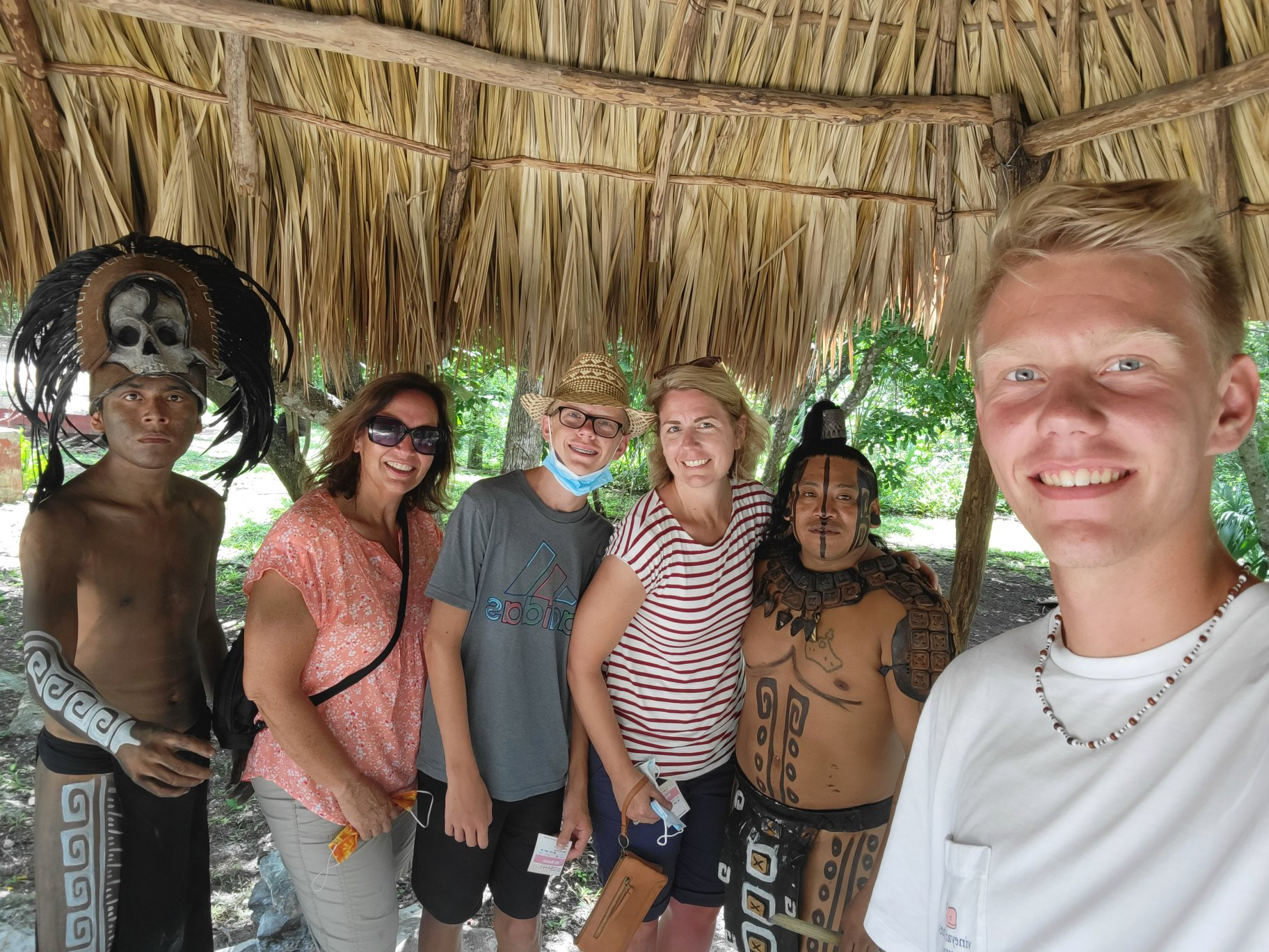 family visiting ek balam and mayan shaman