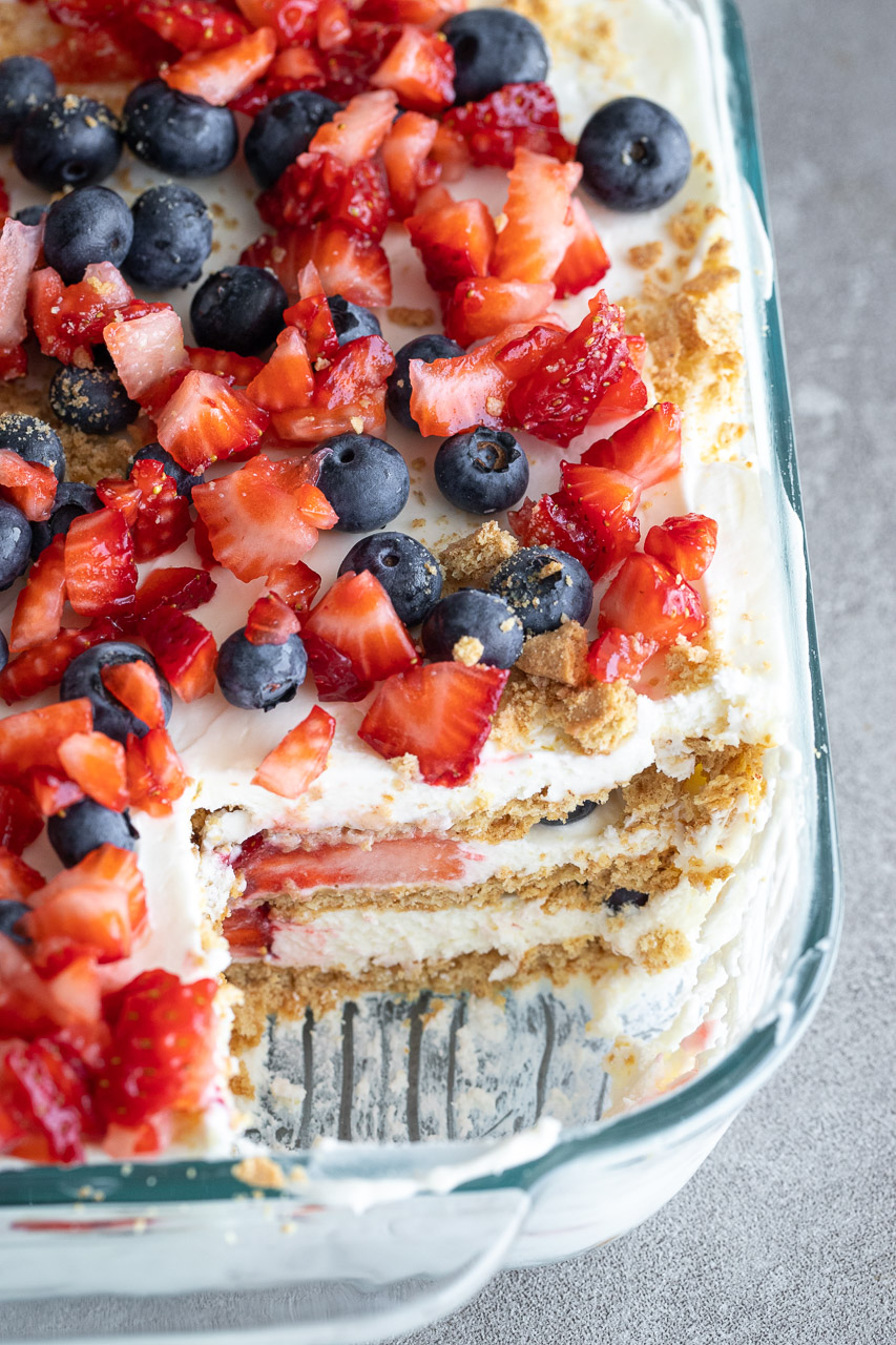 Easy berry icebox cake with a slice cut out of it.