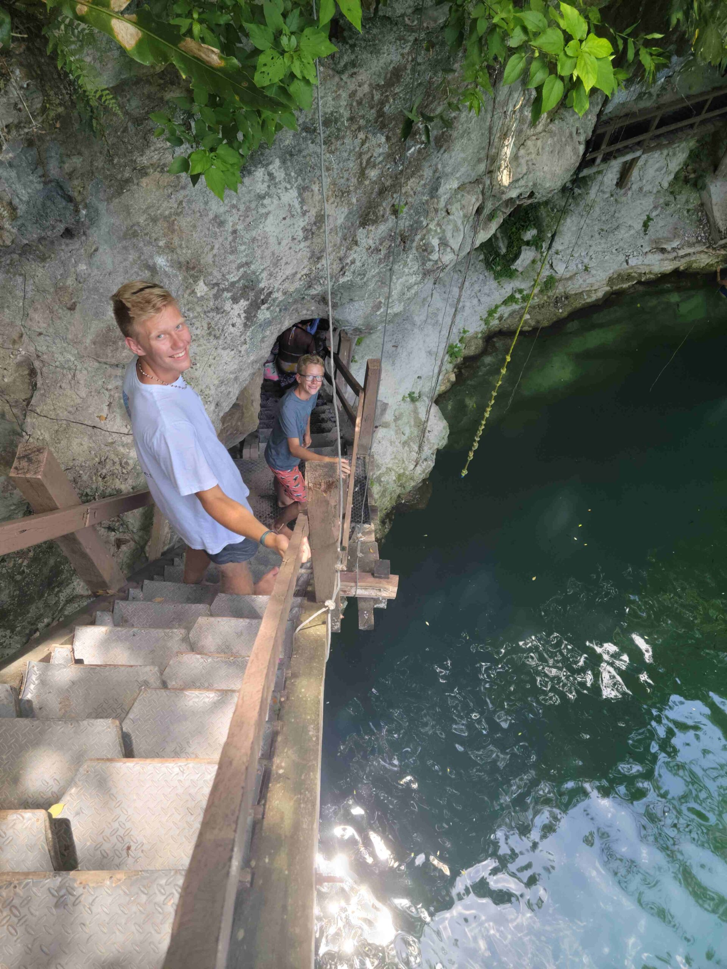 2 teenage boys at cenote x'canche