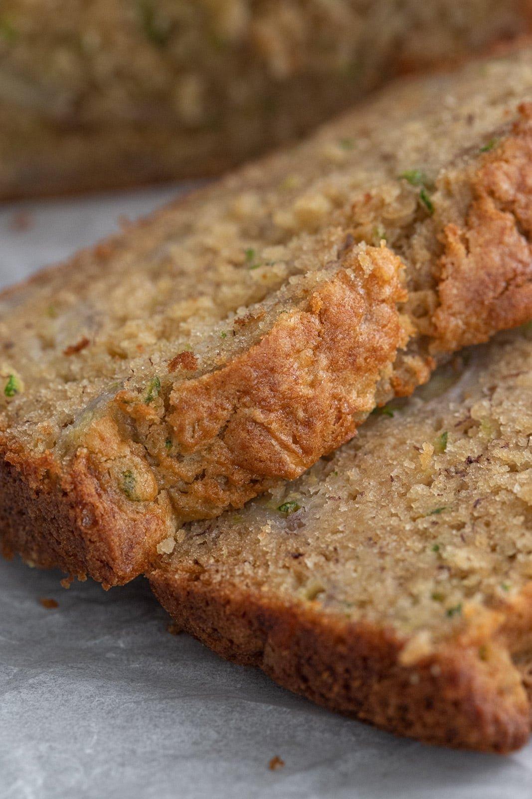 Tops of zucchini bread slices.