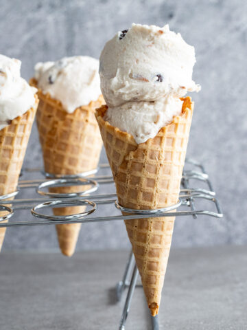 Dairy-free coconut ice cream in a waffle cone.