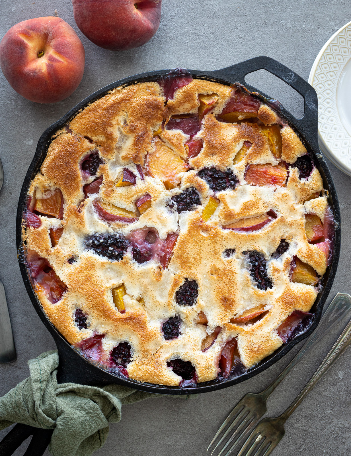 Southern Peach Blackberry Cobbler in a cast iron skillet.