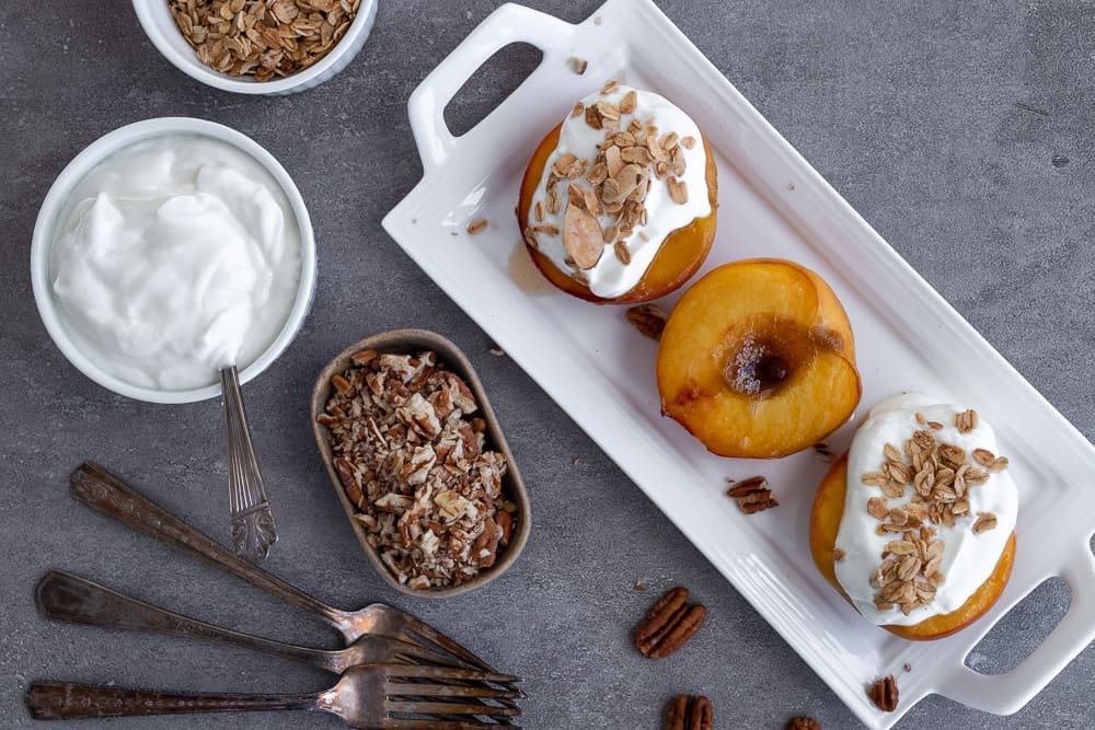 Baked Peaches on a white tray.