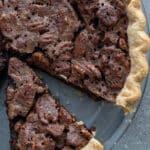 Cut chocolate pecan pie.
