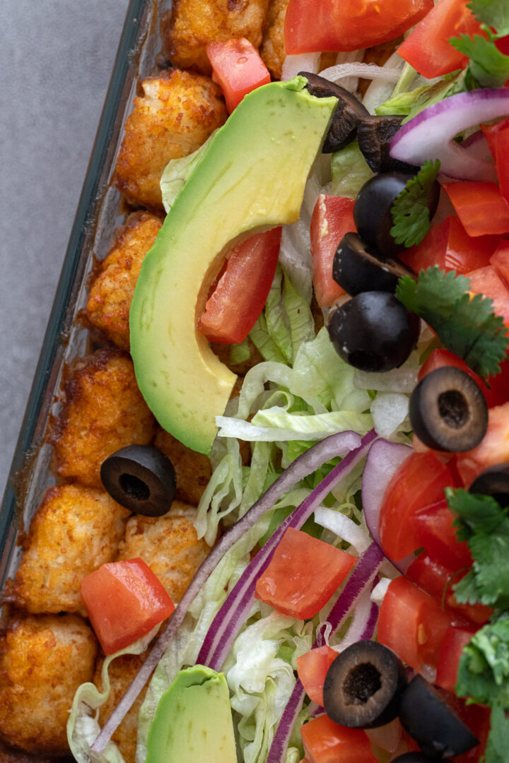 Toppings on a tater tot casserole.