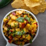 Peach jalapeno salsa in a white serving dish.