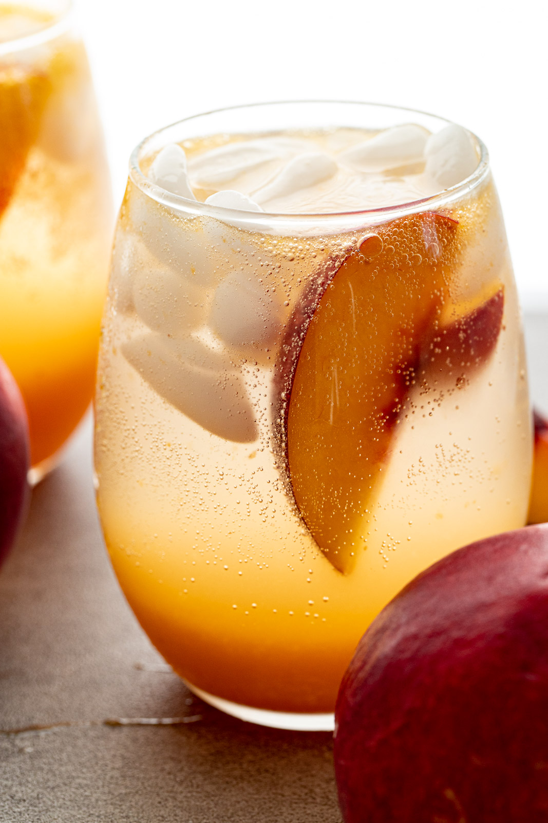 Simple Nectarine Shrub in a glass cup.