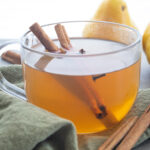 Easy Pear Cider Recipe in a glass mug.