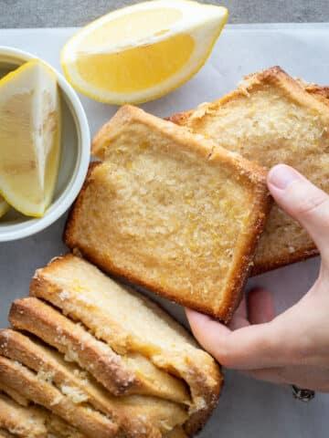 woman holding a piece of lemon brioche pull apart bread.